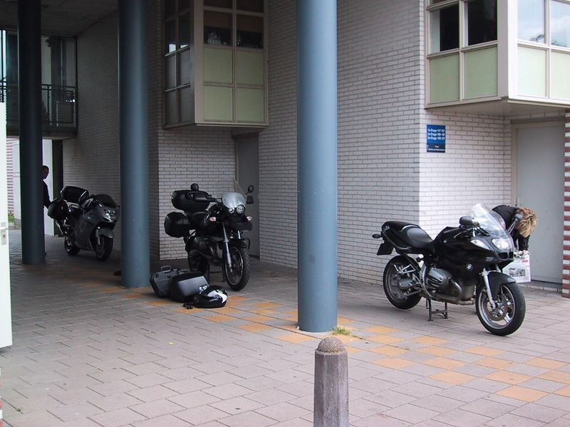 """The three mean machines ready for departure. At the left side of the ring, Pieter's """"need for speed"""" Honda CBR1100XX Blackbird. In the center court, Emile's """"Extended Twin Operations"""" BMW R1150GS ABS and at the right side of the ring Patricia's """"male macho reset"""" BMW R1100S."""