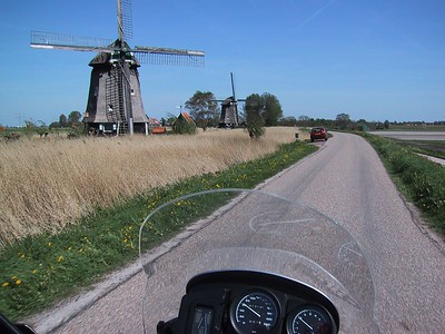 Windmills keeping the polder from flooding line up along our route.
