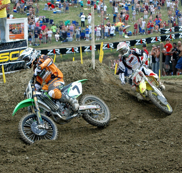 sequence of RC closing on James in Moto 1 , Ricky takes the deep inside rut...