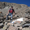 Two large cairns mark the beginning of a 600 foot vertical nightmare of rocks and loose terrain.  It all begins at 13,000 feet elevation.  The terminus of this climb is a saddle which seems to move further away as you ascend.