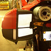 Left Ducati Performance Panniers with Black Reflective Tape Mounted on Multi 01