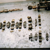 Cam upper left, trans upper right and main bearing caps for both crank and trans beneath.  A lot of components and all required to be removed if your clutch ever needs service.  So, against the backdrop of that effort. You want to do EVERYTHING to your clutch, throwout bearing at one time if the motor down to avoid much wailing and gnashing of teeth later if a problem should arise.