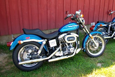 1976 Harley-Davidson FXRS Super Glide similar to this one.  Mine had a fat bob tank conversion with no AMF markings.