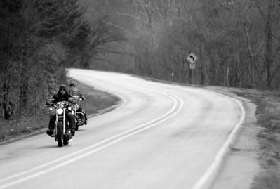 Billy and Eugene Bell riding near their home in the Ozarks on a chilly morning on March 11, 2007. 1/1000th at F3.2.