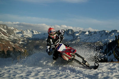 On top of the Mammoth Mountain ski area, throwing roost with a CRF450F equipped with 2Moto's tracks. Who needs ski lifts?