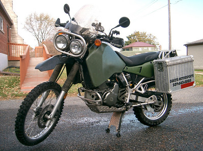 My 2002 KLR650. I just finished washing the bike so I might as well get a quick picture of it. I bought it in the fall of the year and did most of the mods over its first winter. It's the least expensive bike I own but yet the one I'm having the most fun riding.