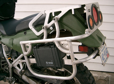I added a pelican case to my aluminum rear rack. I use it to store my tools for the bike.