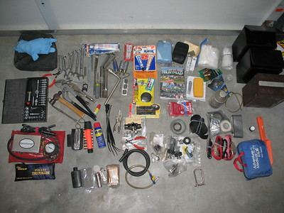This is the contents of my left pannier bag.  Tools and spare parts as well as repair kit items for tires and electrical.  Ready for almost anything.  Not shown is a spare alternator belt,Innertube for emergencies and air cleaner.  The BestRest Cycle-Pump and EZ-Air guage are on the left below the Proxxon tool set.