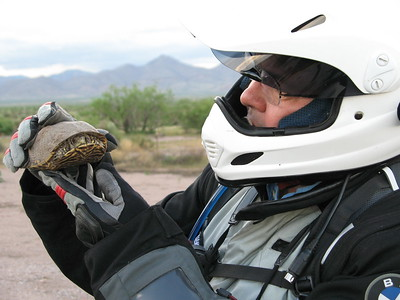 """David comparing helmets with another """"divide rider"""" he met on the road."""