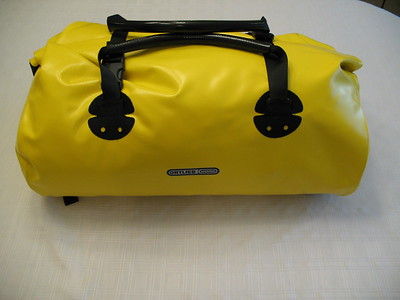 Ortlieb is sponsoring us with the Rack Pack bags.  This Medium bag has a roll top edge with stout buckles to hold it closed and waterproof.