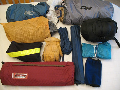 This medium bag holds my tent, fly, ground cloth, poles, pegs, thermarest mattress, sleeping bag, reflective vest, extra leather gloves, neck gaiter and dual-line QuadTrack stunt kite.  There should be room in there for my Keen Newport sandals also.
