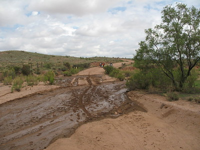 The thunderstorms from the night before caused some flooding of the local arroyo's, creekbeds etc. so we had some muddy crossings to deal with.