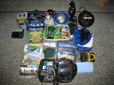 This is the contents of my right pannier bag.  Mostly kitchen gear like stove and fuel bottle, cookset, utensil bag, snack bar case with coffee press.  The black bag holds the GoPro video camera and moto mount set with SD cards and batteries.