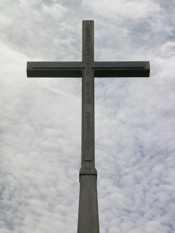 "A closer view of the cross... the inscription is the motto of the 101st ... ""Rendezvous with Destiny"" ... and is made from aluminum taken from one of the emergency doors of the plane."