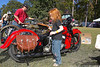 Little Zoey...The Rallye Mascot!  Admires the Antique Harley.