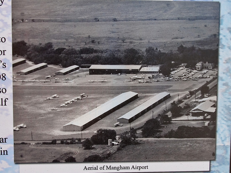Old Aerial view of Mangham Airport. The home is in the center right of the photo. Cardinal Land runs down the right and across the bottom of the photo. The top of the photo is towards the West. The right is North The runway is running North and South.<br /> Stormy Plaza 03-13-10
