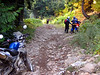 Hyak power line road. Long steep rocky uphill takes it's first victim for the day. Jerry tossed his KLR when he hit a big loose rock halfway up. A few riders helped him get it back up and going on the hill. No serious damage.