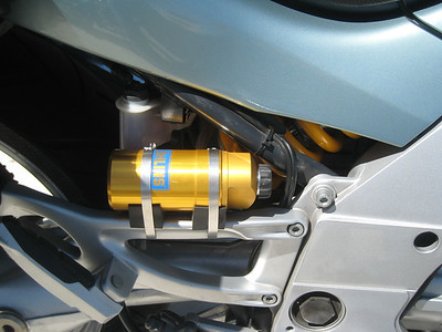 The Ohlins rear shock reservoir, mounted to the footpeg bracket instead of the rear subframe.  This location is required due to the rear brake fluid reservoir, although some folks remove the charcoal cannister and put the reservoir in its place.