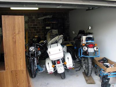 My garage sucks. have to push half the stuff out to the alley to do any work. But I love my bikes.