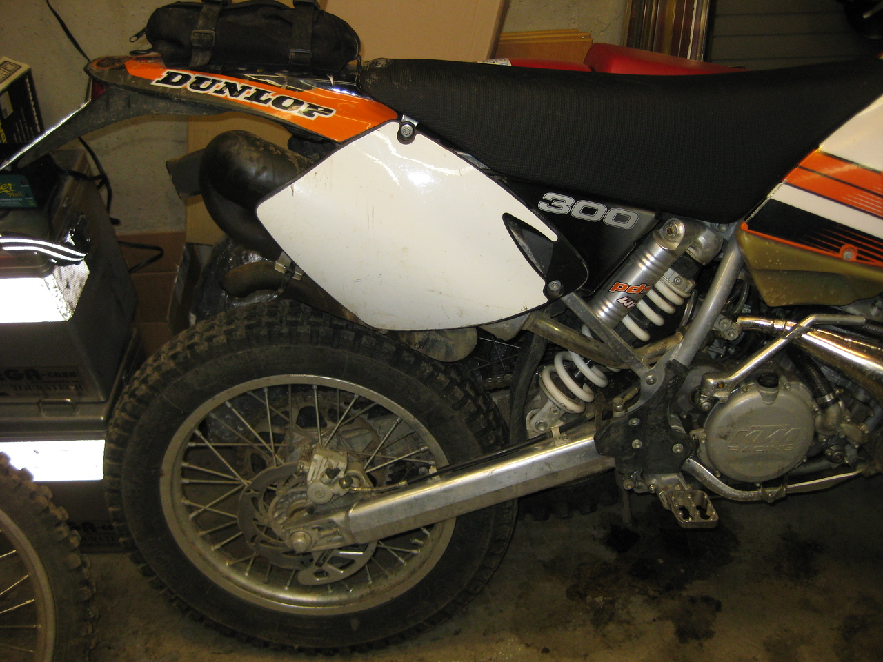 2002 KTM300EXC, Michelin trials tire, EE sharkfin, Fastways pegs, DbSnorkel, FMF silencer, Tall Soft Guts seat.