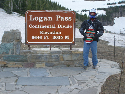 "Take a photo of the ""Logan Pass Continental Divide"" sign."
