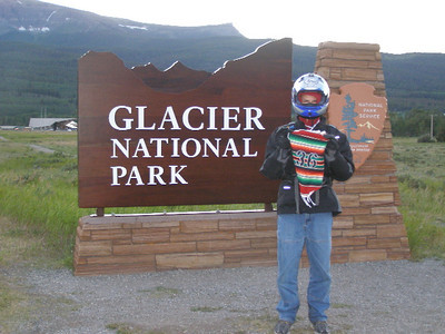 "The large St Mary's entrance sign ""Glacier National Park"" is located on the north side of the Going to the Sun Highway, approximately 0.2 mile west of US-89 in St Mary. There is a large pull out area at the sign. Take a photo of the sign ""Glacier National Park"""