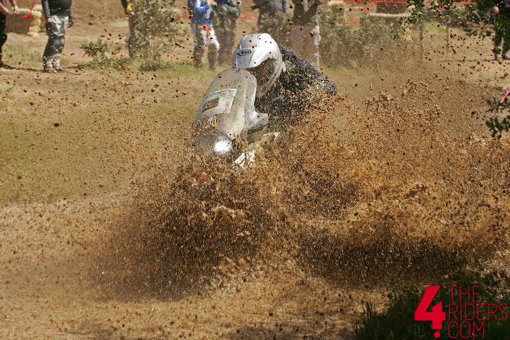 bmw gs splashing through mud and water