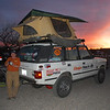 Ann Lockley enjoys an Amado, AZ sunset next to her tricked out Range Rover adventure rig.
