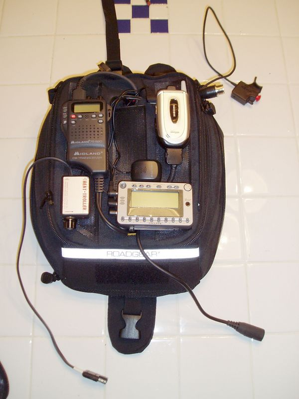 Next, mount all the external devices on the top of the bag.  There's a CB radio, cell phone, XM receiver and heat control for the Gerbing electric clothing.