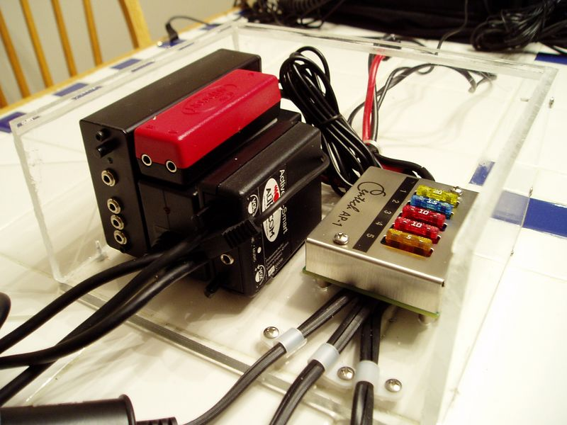 We've got a fuse block for power, an Autocom intercom system, some power supplies, mixers, and three cigarette lighter sockets.