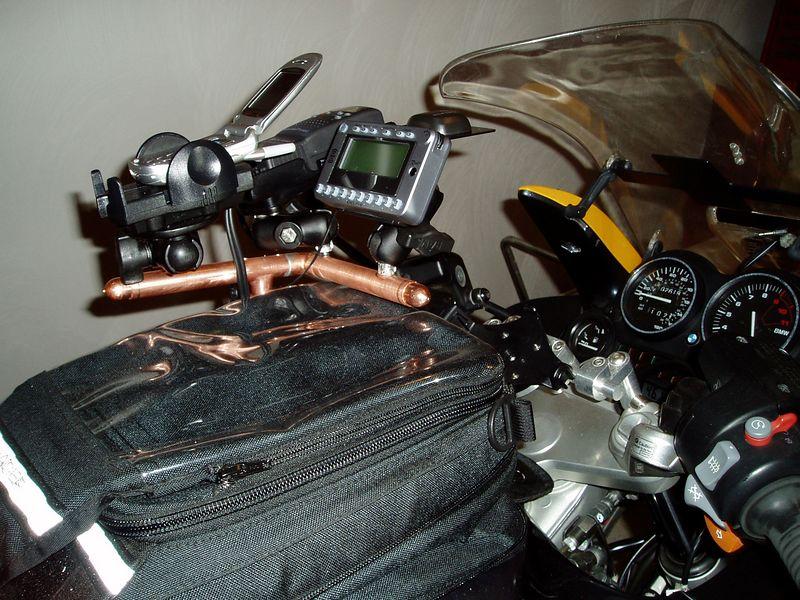 OK, I don't like the tank bag support idea anymore.  The RAM mounts put the devices too high up.