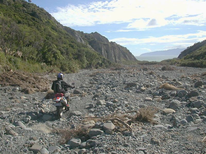 Johnny riding down the Putangirua Stream to Palliser Bay