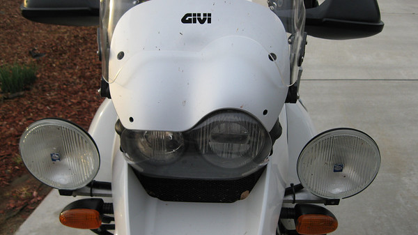Hella's, Givi, Headlight protector, and not so easy to see, oil cooler protector (Touratech painted black)