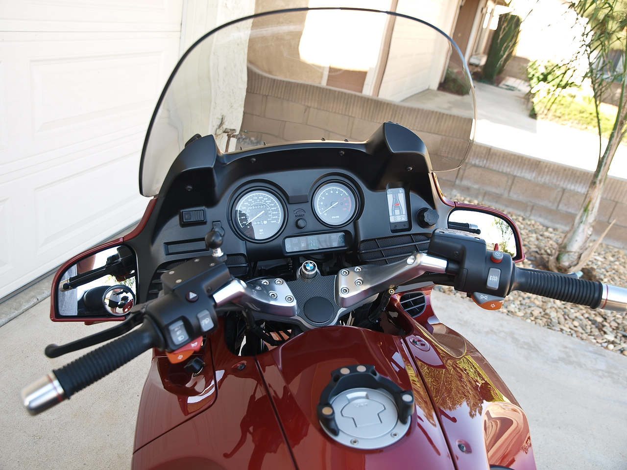 """I also didn't list the carbon fiber trim on the triple tree.  No key scuffs that way.  And the ignition key is BMW logo.  You can also see the Marsee """"corona"""" magnetic tank bag mount in this photo.  I also have little rotating """"blind spot"""" mirrors on the lower inboard corner of the mirrors.  They work great."""