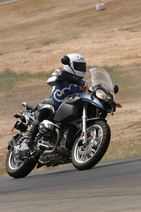 Cecilie on her BMW R1200GS at Thunderhill race circuit (California, USA) June 2007 http://www.balsamfir.com/