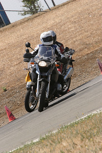 Another GS on her tail :-) Cecilie on her BMW R1200GS at Thunderhill race circuit (California, USA) June 2007 http://www.balsamfir.com/