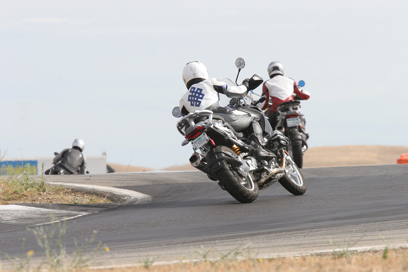 """Cecilie has another GS in her sights :-)<br /> Cecilie on her BMW R1200GS at Thunderhill race circuit (California, USA) June 2007<br />  <a href=""""http://www.balsamfir.com/"""">http://www.balsamfir.com/</a>"""