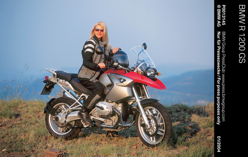 Ok she may be a 'model' and not an R1200GS owner / rider at all, who cares? :-)<br /> 2004 BMW R1200GS promotional image