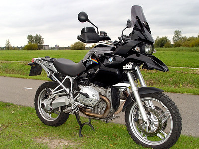 "Ton's (aka ECM) modified / customised 2004 BMW R1200GS I like this bike and I like music, especialy Pink Floyd and their timeless album Dark Side of the Moon...."" The full story of Ton's custom Pink Floyd R1200GS HERE"