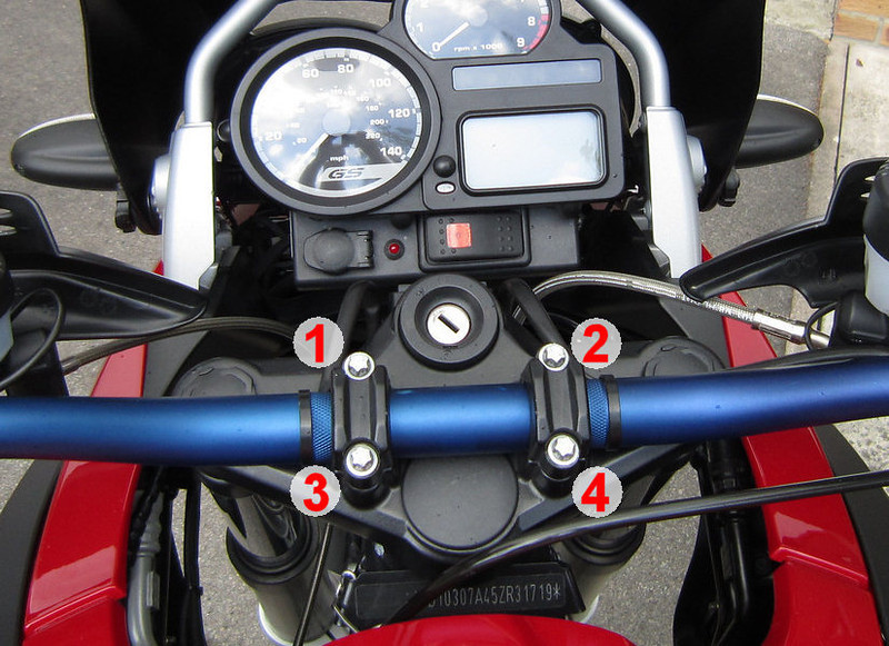 R1200Gs Handlebar Clamp Torque (care 2005/2007 models, may have changed with later bikes;-)<br /> Steel handlebars to fork bridge, (Torx bolts M8 x 30) - 21 Nm (15 ft-lbs)<br /> 1st front, 2nd rear -> gap at rear only (as viewed in forward direction of travel)<br /> Front 1-2, Rear 3-4