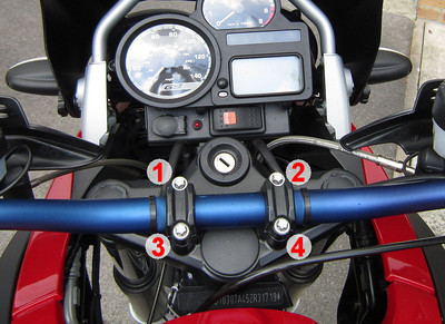 R1200Gs Handlebar Clamp Torque (care 2005/2007 models, may have changed with later bikes;-) Steel handlebars to fork bridge, (Torx bolts M8 x 30) - 21 Nm (15 ft-lbs) 1st front, 2nd rear -> gap at rear only (as viewed in forward direction of travel) Front 1-2, Rear 3-4