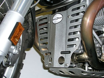 "R12GS SplashGuard protects the fragile plastic alternator cover, as well as the lower exhaust crossover tube.  The SplashGuard is constructed from .105"" aluminum alloy and has an attractive random orbit brushed and sanded finish, protected with by clear powder coat.  $90.00"