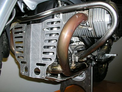 """R12GS SplashGuard protects the fragile plastic alternator cover, as well as the lower exhaust crossover tube.  The SplashGuard is constructed from .105"""" aluminum alloy and has an attractive random orbit brushed finish, protected with a clear powder coat."""