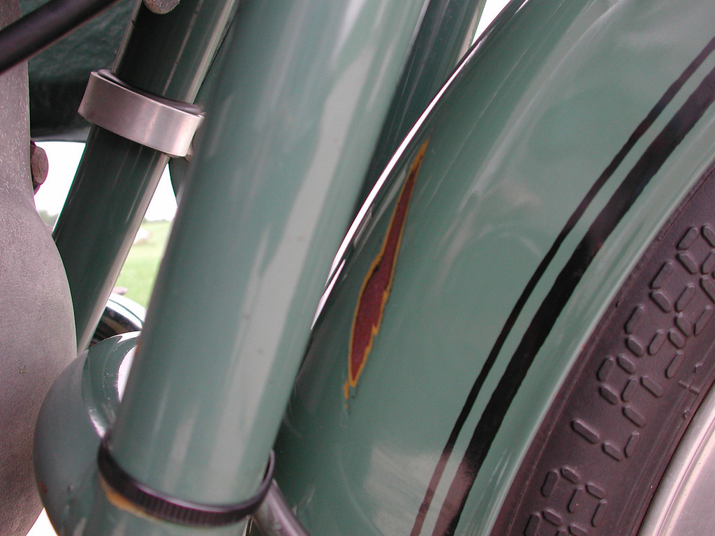This abrasion was caused by the front brake cable over time. The cable is now held away from the fender.