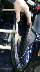 Zippered storage compartments run the length of the bag on both sides.