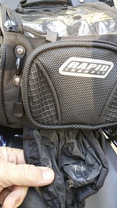 The rain cover stows in a zippered pouch in the lower front of the bag.