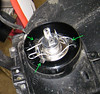 Make sure when re-installing the H4 bulb that you line it up in the orientation shown (green arrows). The bulb will drop into place when properly aligned. Then bring spring wires back over the bulb base and re-hook on the plastic hook tabs.