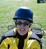 Gateway Riders treasurer Rich Race tries on a helmet that is too small.