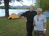 "George and Larry in camp.  Al sent this via Blackberry and I think these two are saying, ""See what you are missing... nice camp by the lake!""  Photo by Al."