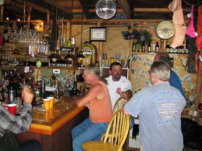 I think that's Kimbal's arm, Banker Bob, Fins, R.E.'s head, and DP in the bar.